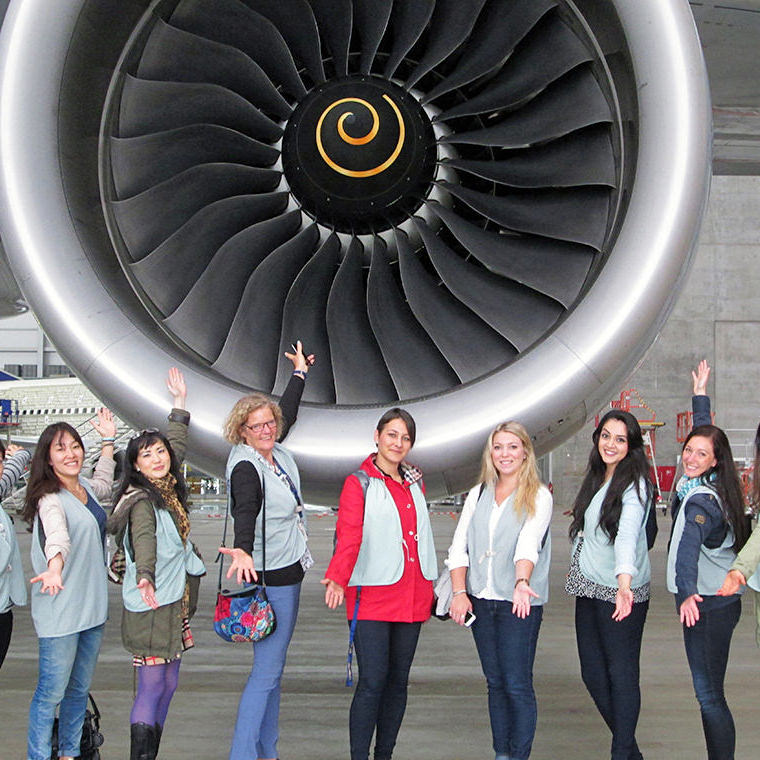 Standing in front of an aeroplane engine