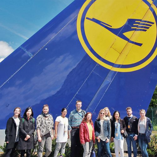 Standing in front of the Lufthansa logo